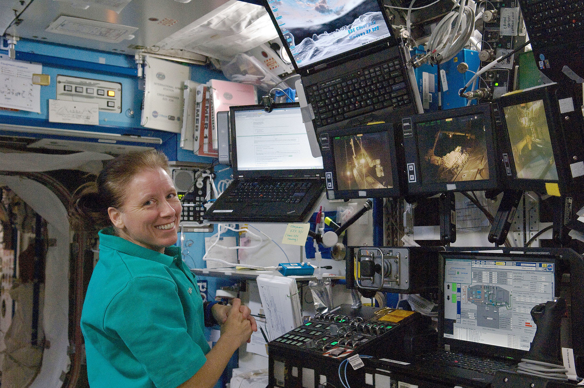 NASA astronaut Shannon Walker, Expedition 24 flight engineer, is pictured near a robotic workstation in the Destiny laboratory of the International Space Station. One day I'll have a workstation as cool as hers. LICENCE: Public Domain.