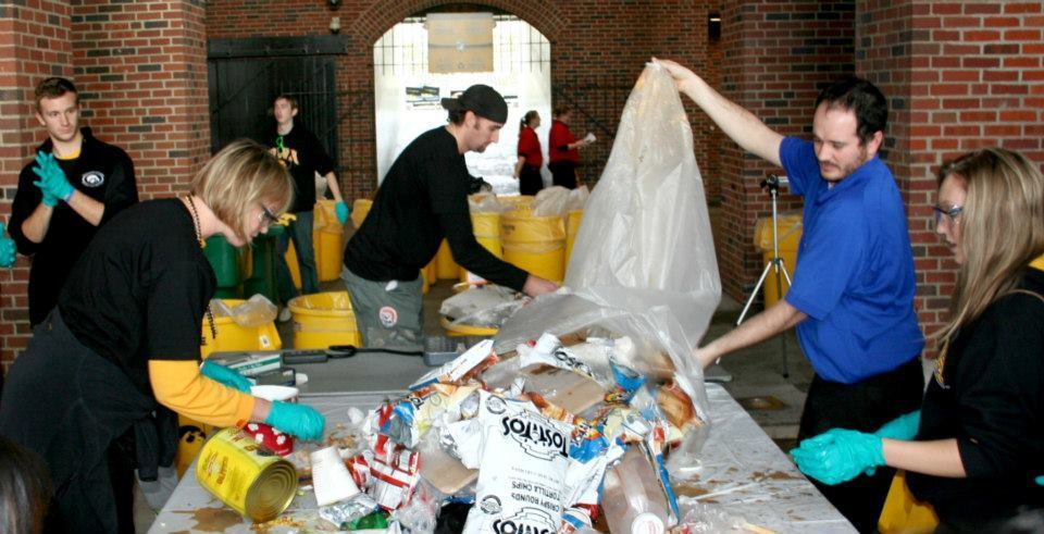 Volunteers perform a 'Dumpster Dive' waste audit after a football game in Kinnick Stadium at the University of Iowa in Iowa City, Iowa