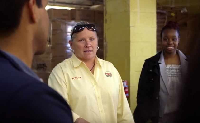 Toyota employees teach Hurricane Sandy food bank staff how to reduce time to distribute food in New York