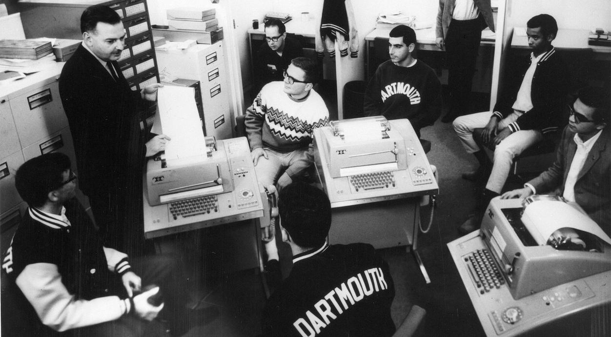 BASIC co-inventor John G. Kemeny with some students at teleprinters connected to the DTSS - image courtesy of Dartmouth College Library